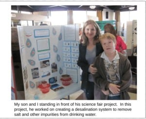 My son and I standing in front of his science fair project. In this project, he worked on creating a desalination system to remove salt and other impurities from drinking water.