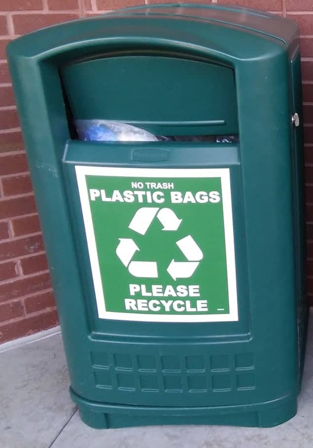 A plastic recycling collection bin found outside the grocery store