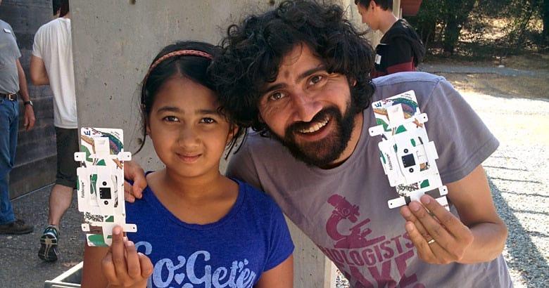 Manu Prakash, co-creator of the Foldscope (right)