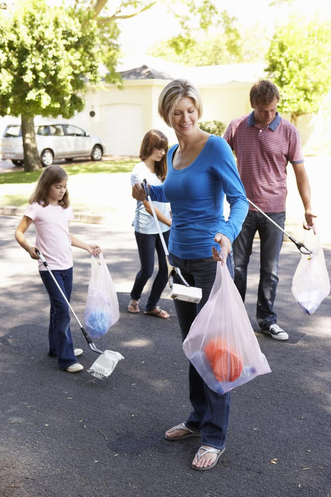 Family Picking up Litter in Their Neighborhood